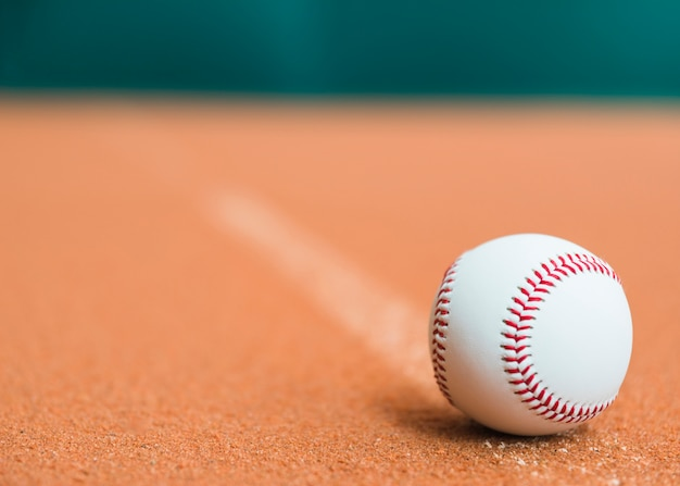 White baseball on pitchers mound Free Photo