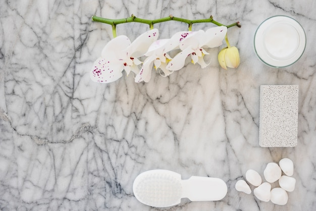 White bathroom products on marble surface Free Photo