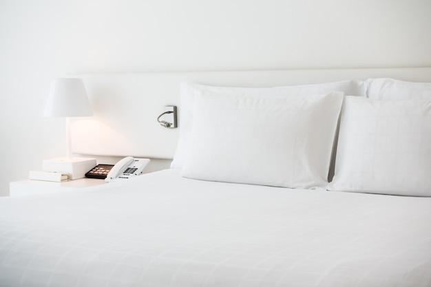 White bed with white pillows Free Photo