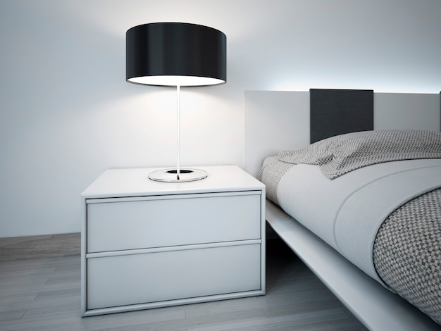 White bedside table with black lampshade lamp near the bed in modern bedroom. Premium Photo