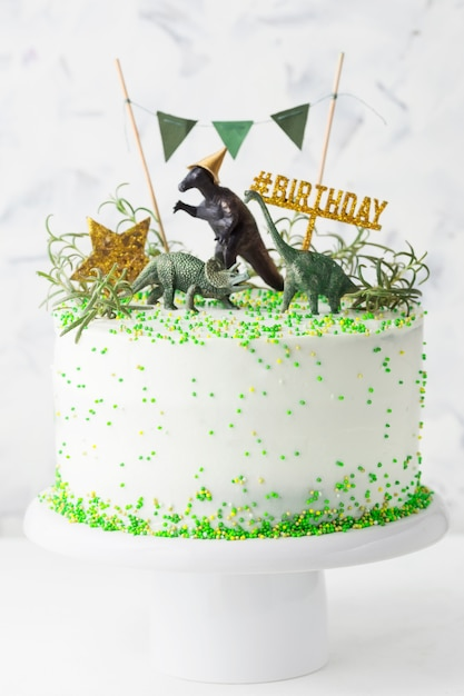 White Birthday Cake With Green Decorations Gold Star And
