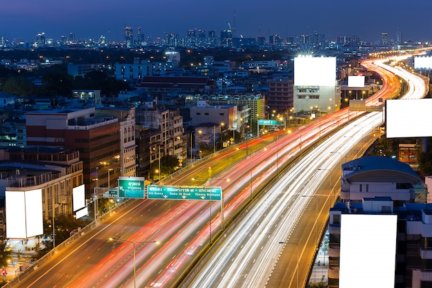 White blank billboard on the highway in the twilight time in downtown bangkok thailand Premium Photo