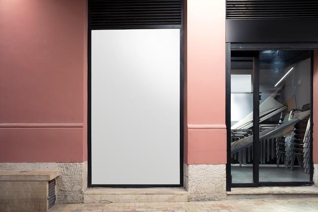White blank billboard near the entrance Free Photo