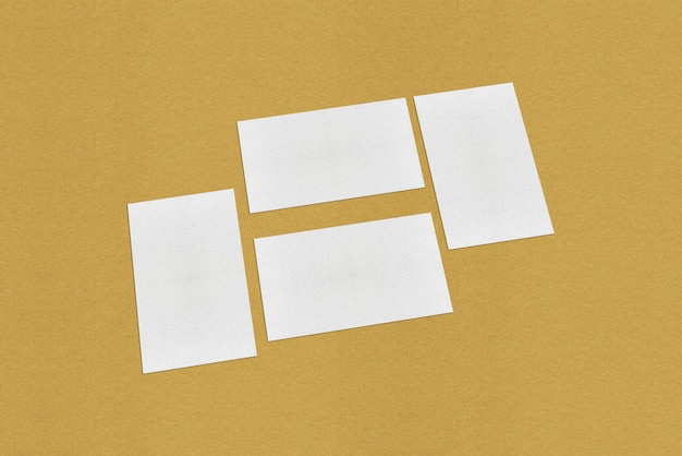 White blank business card template, white business card on golden background Premium Photo