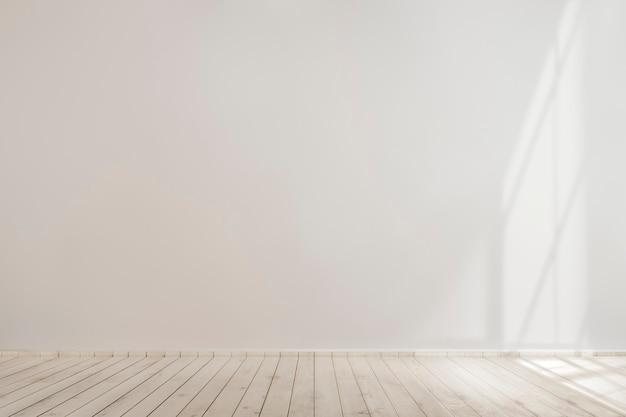 Mockup di muro di cemento bianco bianco con pavimento in legno Foto Gratuite