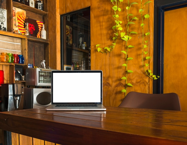 White blank screen laptop on dining table at home Free Photo