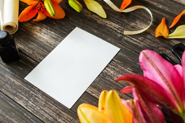 White blank sheet on wooden background with decorations Premium Photo