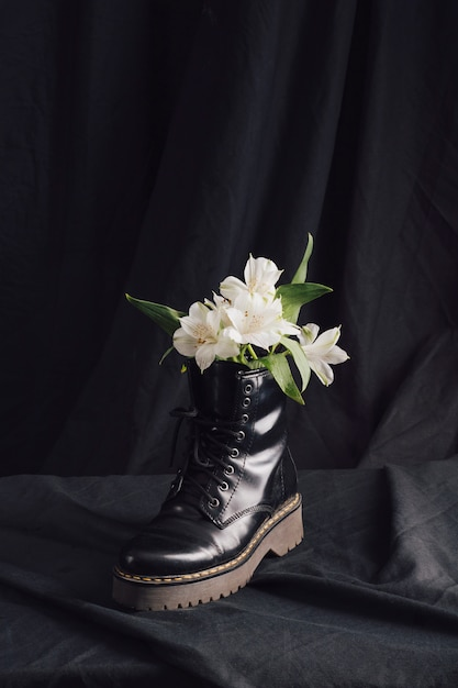 White blooms in dark boot Free Photo