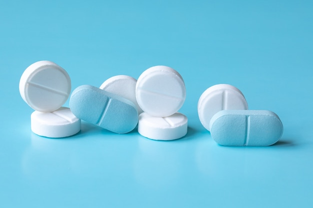 Premium Photo White And Blue Tablets Or Pills Or Medication Or Drugs