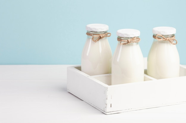 White box with bottles of milk Free Photo