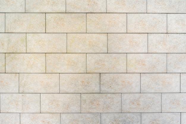 白いレンガの壁。灰色の詰物とレンガの質感 無料写真