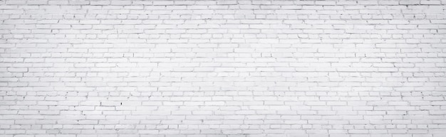 White brick wall, texture of whitened masonry as a background Premium Photo