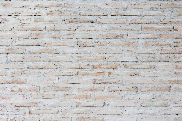 White and brown brick wall background, background of old vintage wall with peeling plaster Premium Photo