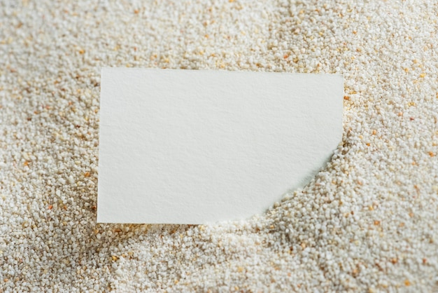 White business card on sand Free Photo
