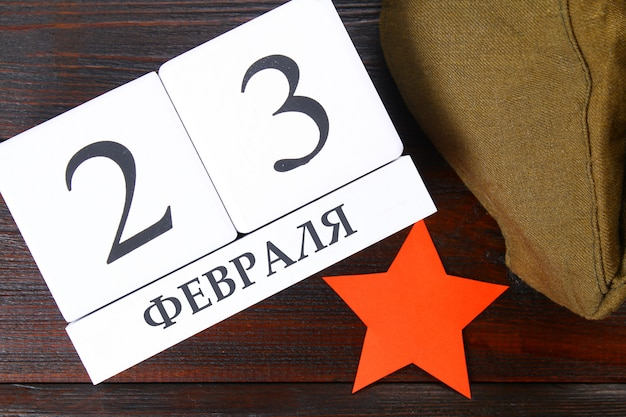 White calendar with russian text: february 23. holiday is the day of the defender of the fatherland. Premium Photo