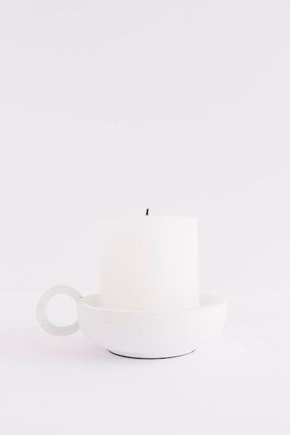 Candela bianca a candelabro Foto Gratuite