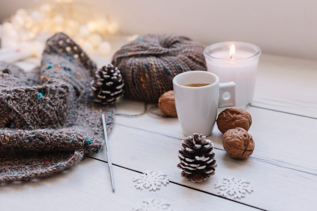 White candle with grey knitting threads Free Photo