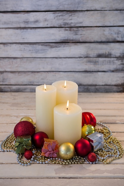 White candles lit with christmas decoration Free Photo