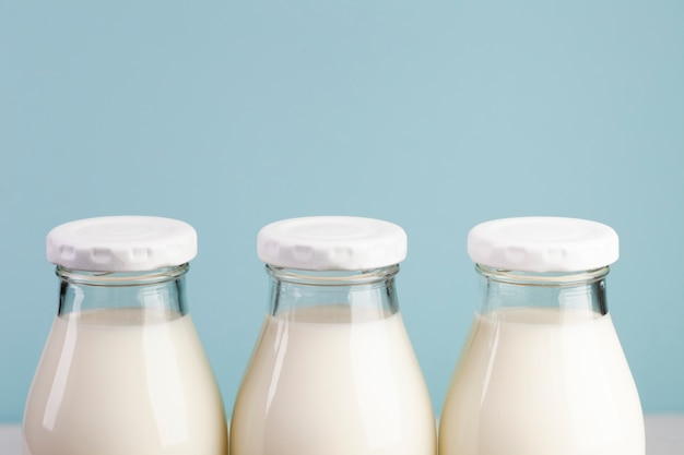 White caps from bottles filled with milk Free Photo