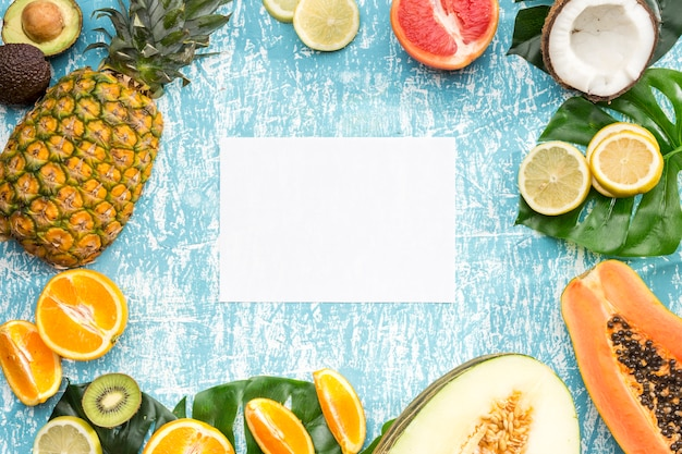 White card surrounded by exotic fruits Free Photo