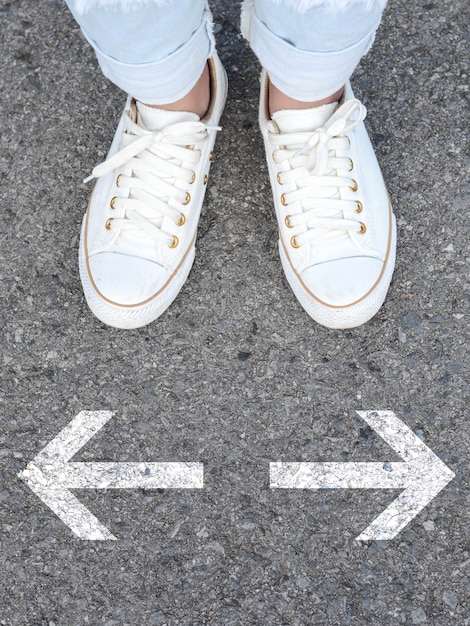White casual shoes making decision Photo | Premium Download