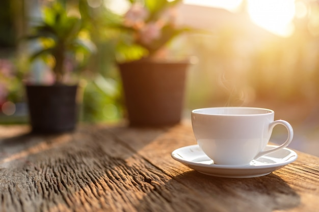White ceramic coffee cup on wooden table or counter Premium Photo