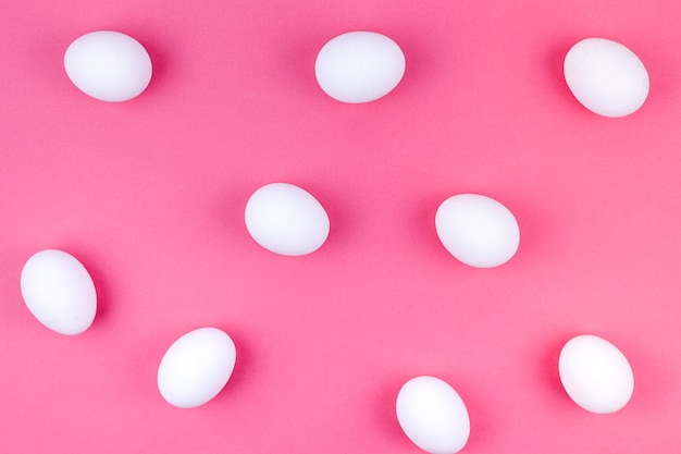 White chicken eggs scattered on table Free Photo