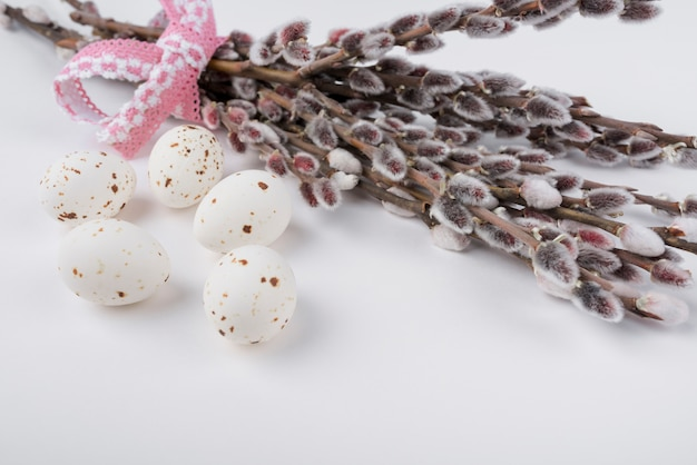 White chicken eggs with willow branches Free Photo