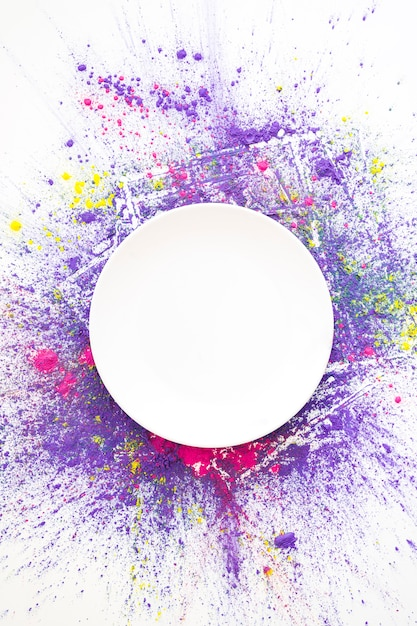 White circle on pink, violet and yellow bright dry colors Premium Photo