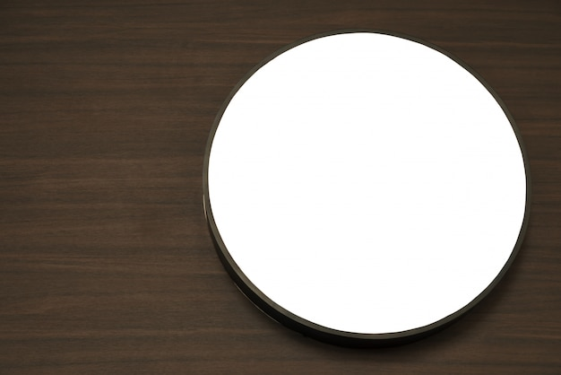 White circle on a wooden table Free Photo