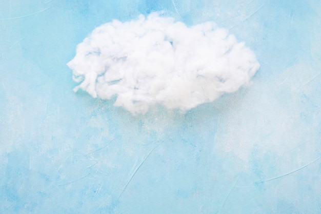 White cloud against blue backdrop Free Photo