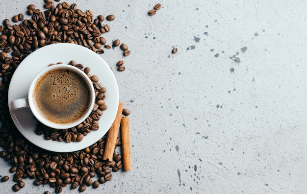 White coffee cup with fragrant espresso on grey background Premium Photo