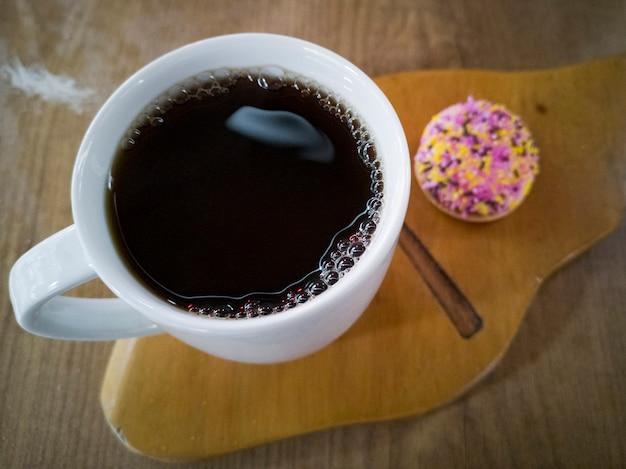 White coffee mug and cake Premium Photo
