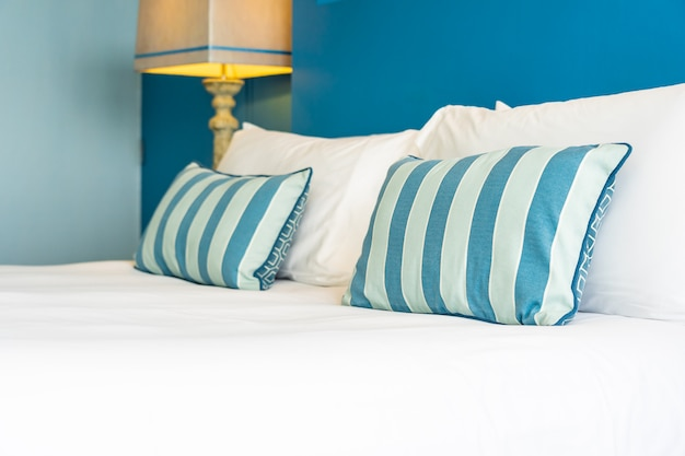 White comfortable pillow on bed decoration interior Free Photo