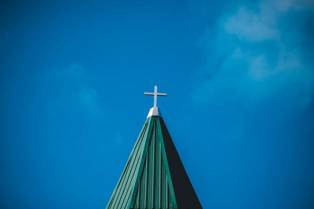 White concrete cross under clear blue sky Free Photo