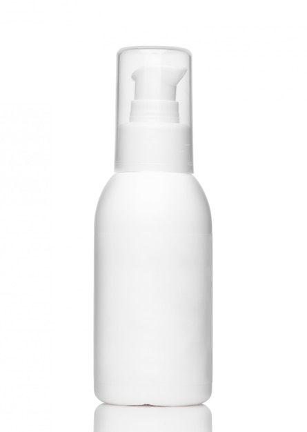 White cosmetic bottle with dispenser and transparent cap isolated on a white background Premium Photo