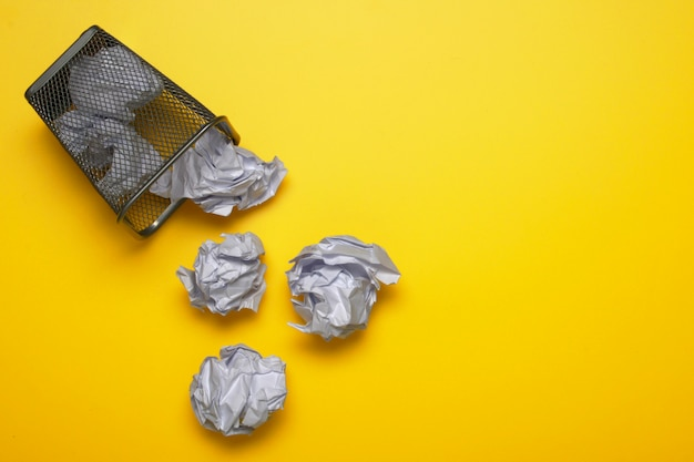 White crumpled paper balls with a trash can. metal basket. copy space for text. Premium Photo