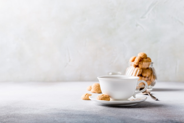 White cup of coffee with amaretti cookies Premium Photo