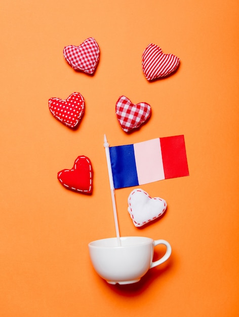 White cup and heart shapes with france flag Premium Photo