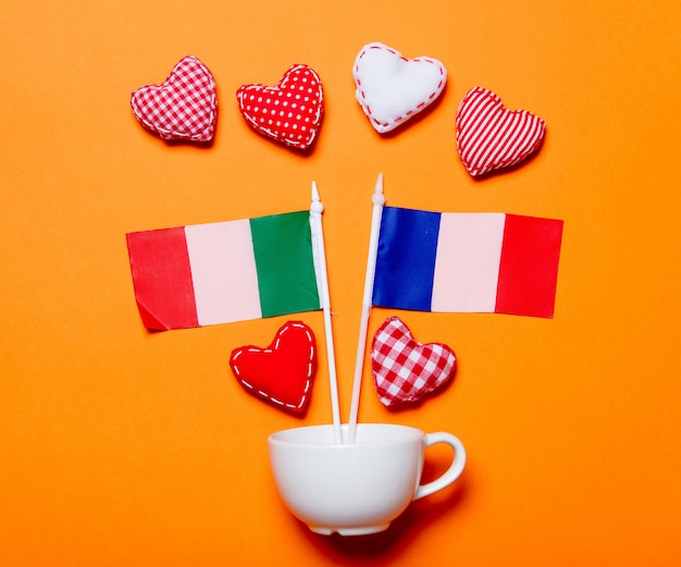 White cup and heart shapes with france nad italy flags Premium Photo