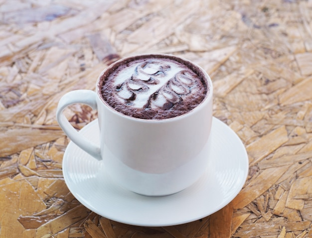 White cup of hot chocolate on wooden table. Premium Photo