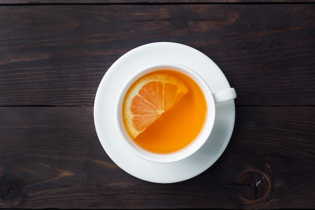 White cup with natural herbal tea with lemon cinnamon Premium Photo