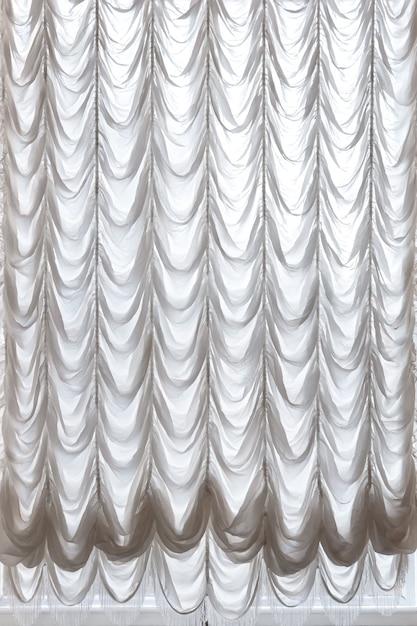 흰색 커튼 드레이프 극장. 커튼 배경. 프리미엄 사진