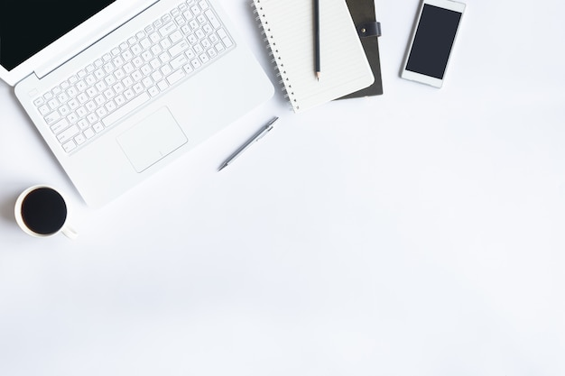 White desk office on flat lay. top view on desk table essential elements. Premium Photo