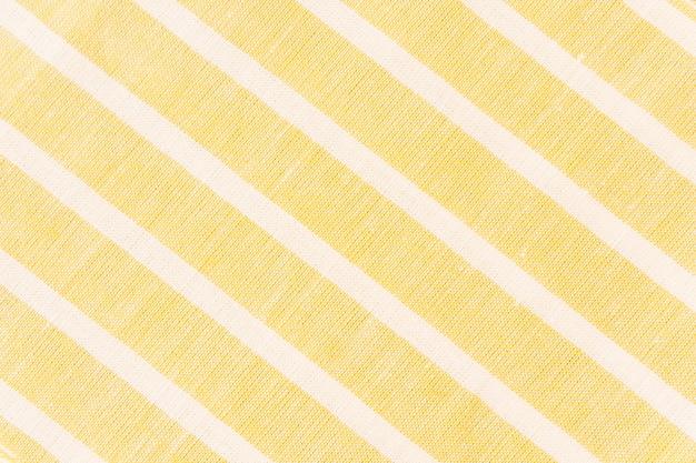 White diagonal line on yellow fabric Free Photo