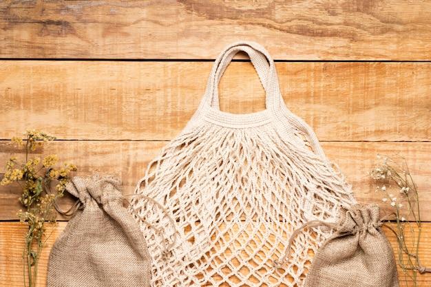 White eco friendly bag on wooden background Free Photo