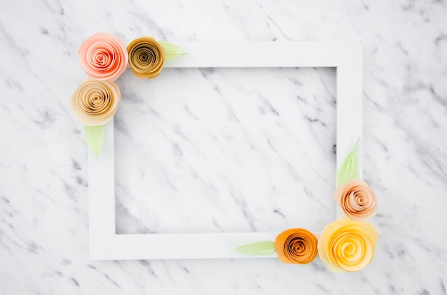 White elegant floral frame on marble background Free Photo