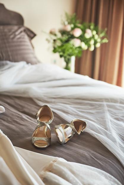 White Elegant Wedding Dress Veil And Shoes Lying On The