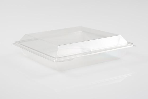白い空の空の発泡スチロールのふたが付いているプラスチック食糧皿の容器箱 Premium写真