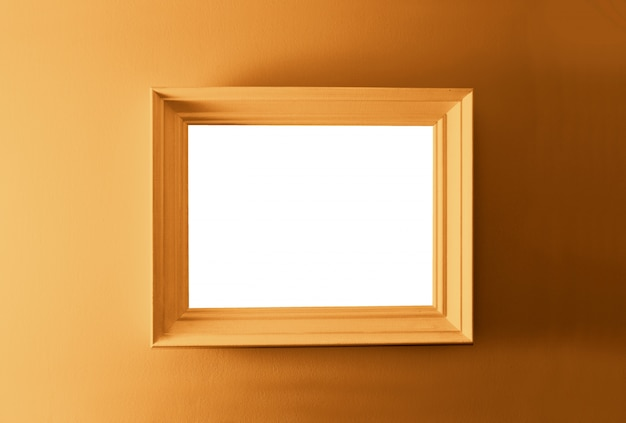 White empty frame on the bronze wall Free Photo